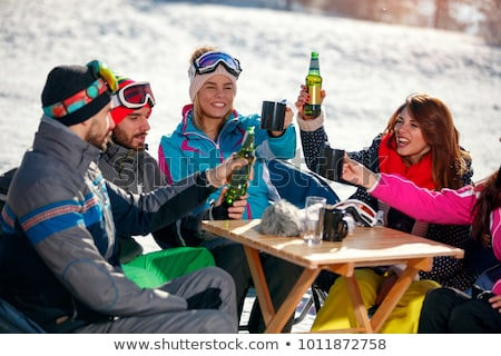 friends drinking in ski lodge bar Stock photo © IS2