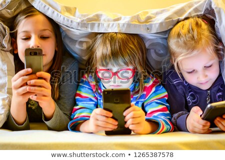 Kid using internet faced with cyberbullying. Stock photo © vinnstock