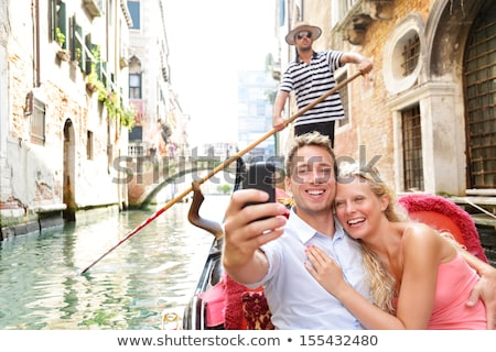 Couple in Venice, taking pictures Stock photo © IS2