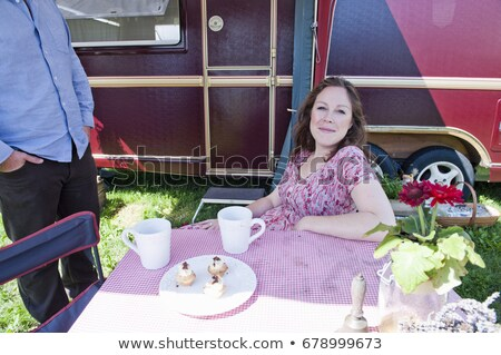 Woman picnicking outside trailer Stock photo © IS2