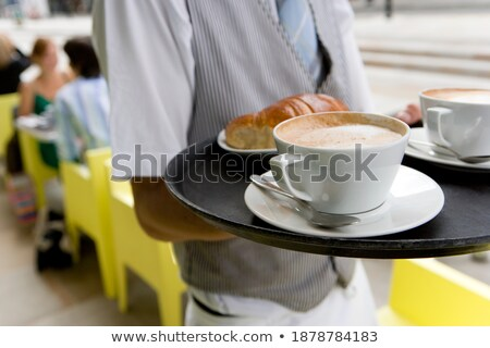 Mid section of waiter holding cup of coffee Stock photo © wavebreak_media
