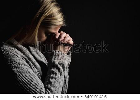 Woman praying and crying Stock photo © rogistok