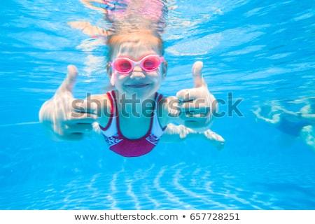 kadın · yüzme · sualtı · havuz · gülen · genç - stok fotoğraf © kzenon