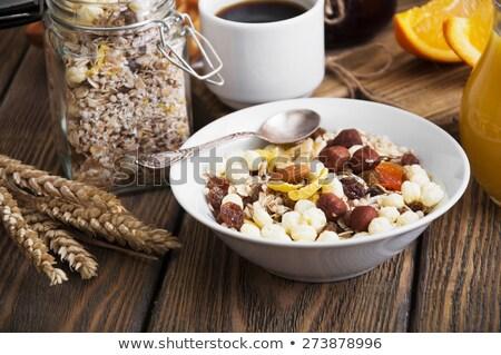 Healthy breakfast with corn flakes, yogurt and croissants Stock photo © Melnyk