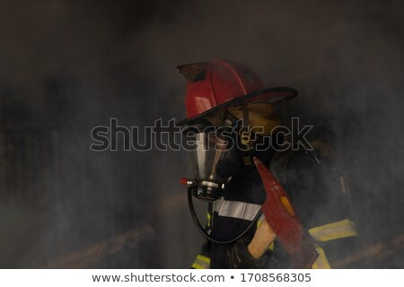 fireman with axe and hydrant Stock photo © studiostoks
