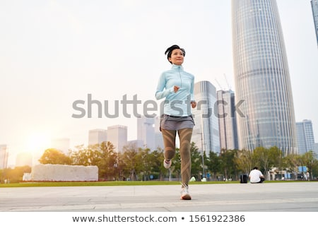 Asian woman jogging Stock photo © elwynn