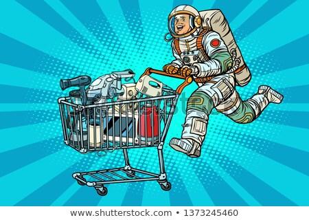 Astronaut on sale of home appliances Stock photo © studiostoks