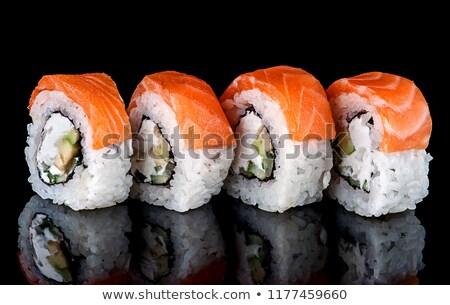 Stok fotoğraf: Sushi Roll Philadelphia In Row Rotated