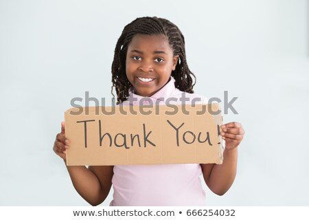 girl holding cardboard with thank you text stock photo © andreypopov