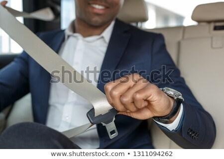 Handsome man fastening safety belt Stock photo © Minervastock