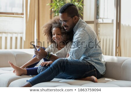 dos · hermanos · sesión · sofá · leer - foto stock © Lopolo