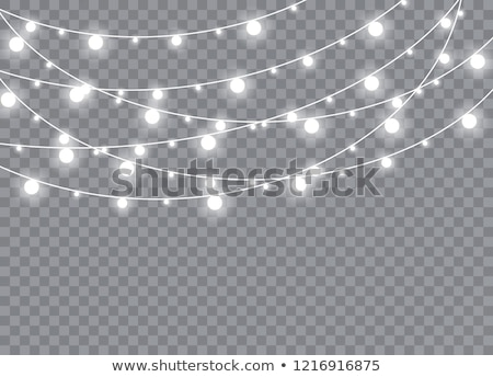 Xmas Color garland, festive decorations. Glowing christmas lights transparent effect decoration on d Stock photo © olehsvetiukha