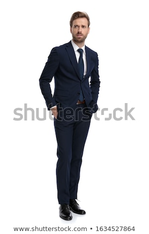 Stock photo: pensive businessman walks to side with hand in pockets
