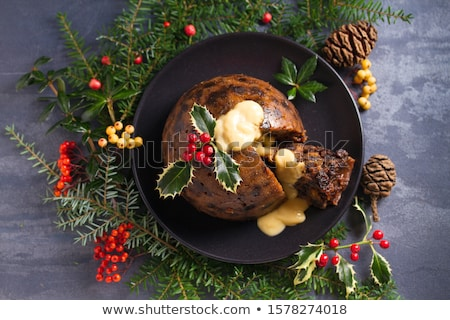 Christmas Pudding Cake Topped With Holly And Berries Stock photo © hittoon