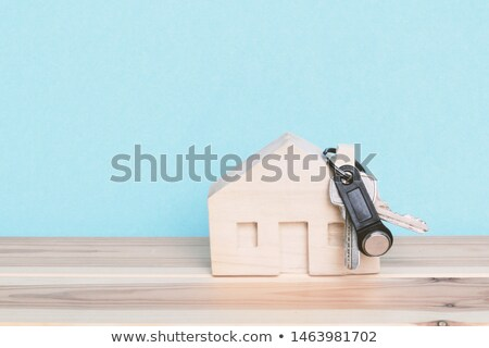wooden miniature house and a door key on a wooden background Stock photo © mizar_21984