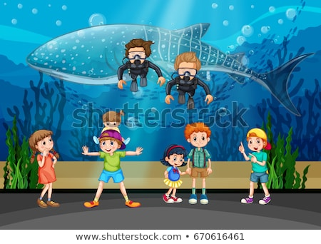 Kids looking at whale and divers in aquarium Stock photo © colematt
