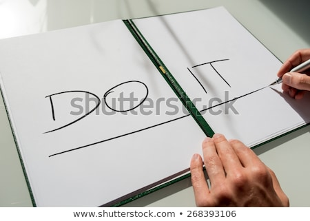 Capital letters on notebook Stock photo © netkov1