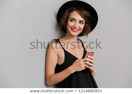 Fotografia przepiękny kobieta 20s czarna sukienka Zdjęcia stock © deandrobot
