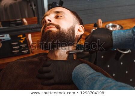Fej férfi kéz fodrász szakáll oldalnézet Stock fotó © Kzenon