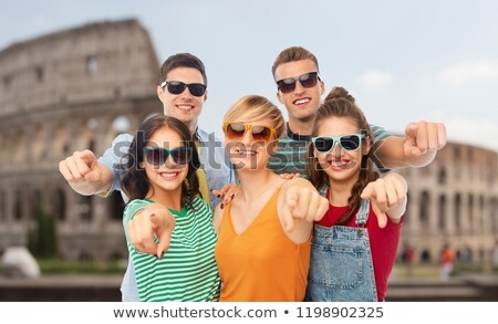 friends in shades pointing at you over coliseum Stock photo © dolgachov