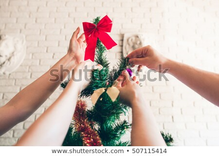 christmas preparation girl decorating pine tree stock photo © robuart
