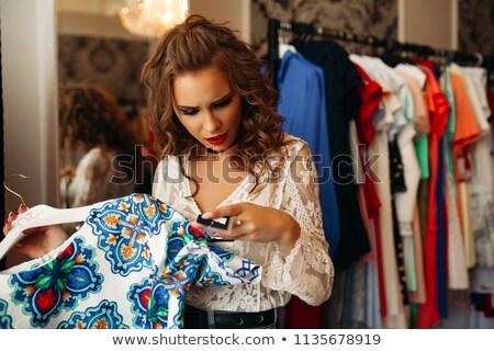 Barna hajú lány meglepődött néz ár vörös ruha Stock fotó © studiolucky