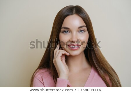 photo of caucasian woman with long dark hair and clean skin touc stock photo © deandrobot