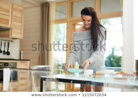 young woman preparing food in the rustic kitchen stock photo © boggy