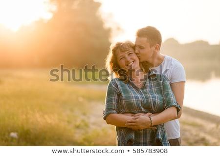Anya fiú ölel csók nő égbolt Stock fotó © ElenaBatkova