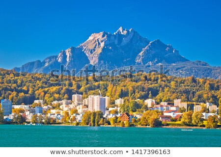 Idílico ciudad lago montana vista Foto stock © xbrchx