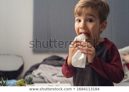 Three kids eating snack on bed stock photo © colematt