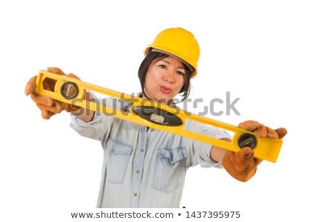 Latino weiblichen Auftragnehmer halten Ebene tragen Stock foto © feverpitch