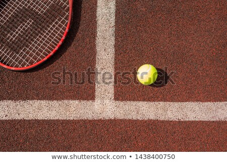 Overview of tennis ball and part of racket on playground Stock photo © pressmaster