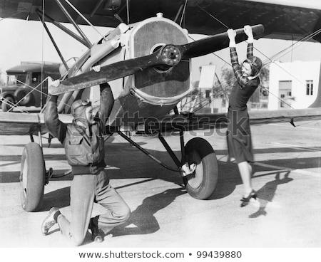 Vrouw piloot vintage vliegtuig pop art Stockfoto © studiostoks
