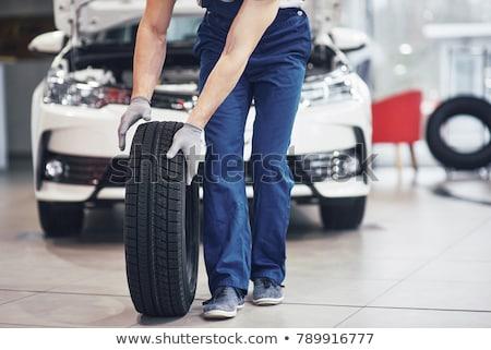 Car in a garage for maintenance, oil/tyre change Stock photo © lightpoet