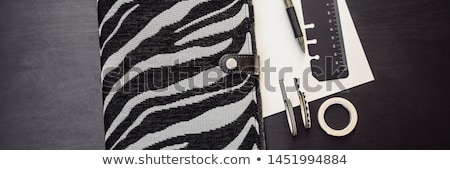 notepad and stationery on a black background planner for business and study fans of stationery stock photo © galitskaya