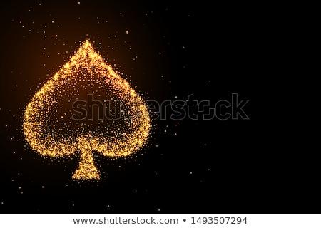 glowing golden glitter spades symbol on black background Stock photo © SArts