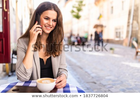 teenage girl calling on smartphone at city cafe stock photo © dolgachov