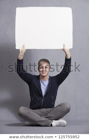 Joyous man showing white empty signboard. Stock photo © lichtmeister