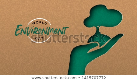Green papercut nature concept of hand with tree Stock photo © cienpies