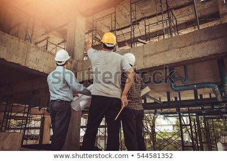 строителя глядя здании план женщину Сток-фото © Kzenon