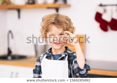 Feliz cute pequeño nino delantal Foto stock © pressmaster