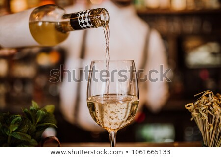 View at young man tasting white wine Stock photo © boggy