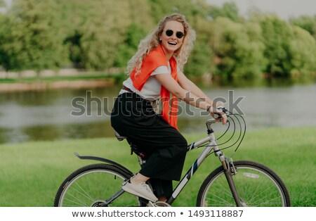 Güzel aktif kadın bisiklet Stok fotoğraf © vkstudio