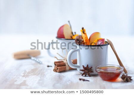 Hot drink with spices in authentic cup Stock photo © dariazu