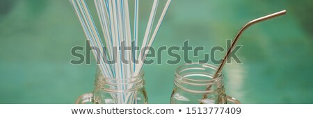 Steel drinking vs disposable straws on pool background. Zero waste concept BANNER, LONG FORMAT Stock photo © galitskaya