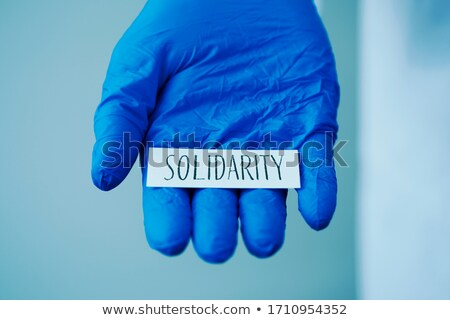doctor man showing the word solidarity in a note Stock photo © nito
