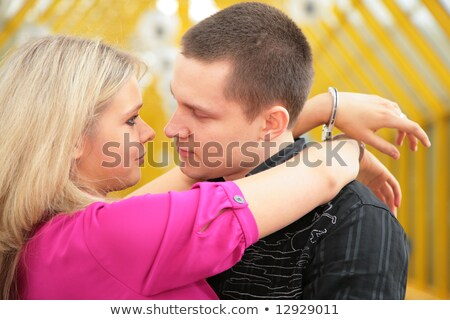 young couple with handcuffs on footbridge stock photo © paha_l