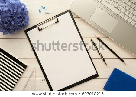 white paper on a clipboard and a blue pen stock photo © latent