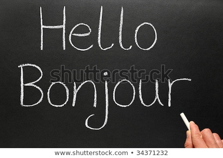 Bonjour, hello in French written on a blackboard. Stock photo © latent